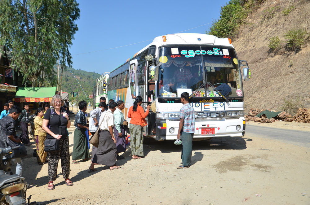 The bus from Mraug U to Mandalay at a stop going up the mountains towards Magwe