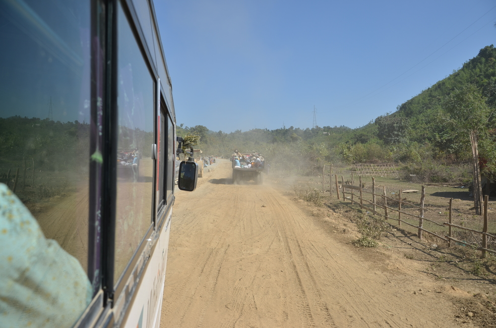 Dusty roads are often driven by intercity buses. You can do as the locals and just take a truck