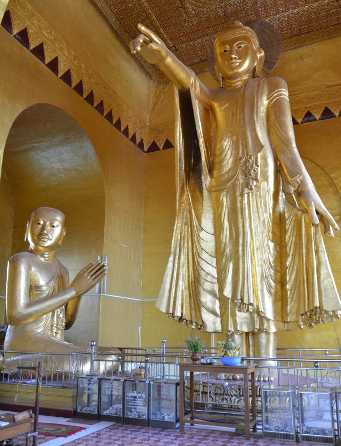 Buddha points to predict where the future capital of Burma will be raised. He points at the palace in Mandalay, which were home of the last Burmese king, Thibaw