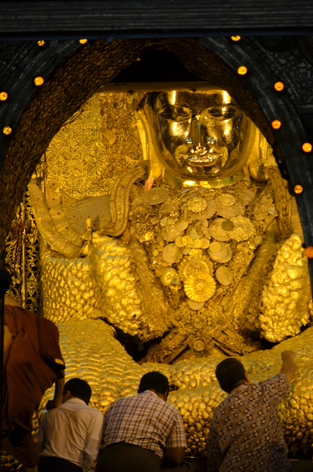 A several cm thick layer of gold leaf covers the Buddha