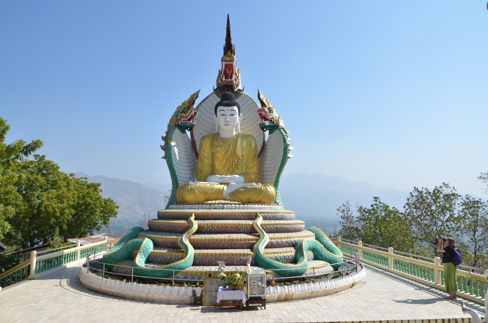 The Buddha guarded by the Cobra or Dragon meets you when you reach the summit